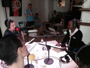 Ibrahima de Voix d'Exils interviewé par Fabien de radio Django. Photo: Voix d'Exils.